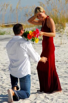 Man offering woman flowers