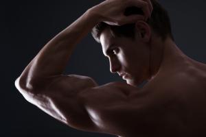 Stylized portrait of muscular man flexing bicep